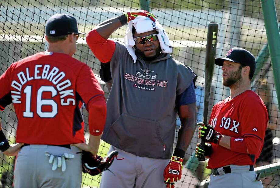 Boston Red Sox designated hitter David Ortiz, center, talks with third baseman Will Middlebrooks, left, and second baseman Dustin Pedroia during practice Tuesday in Fort Myers, Fla. Photo: Steven Senne — The Associated Press  / AP