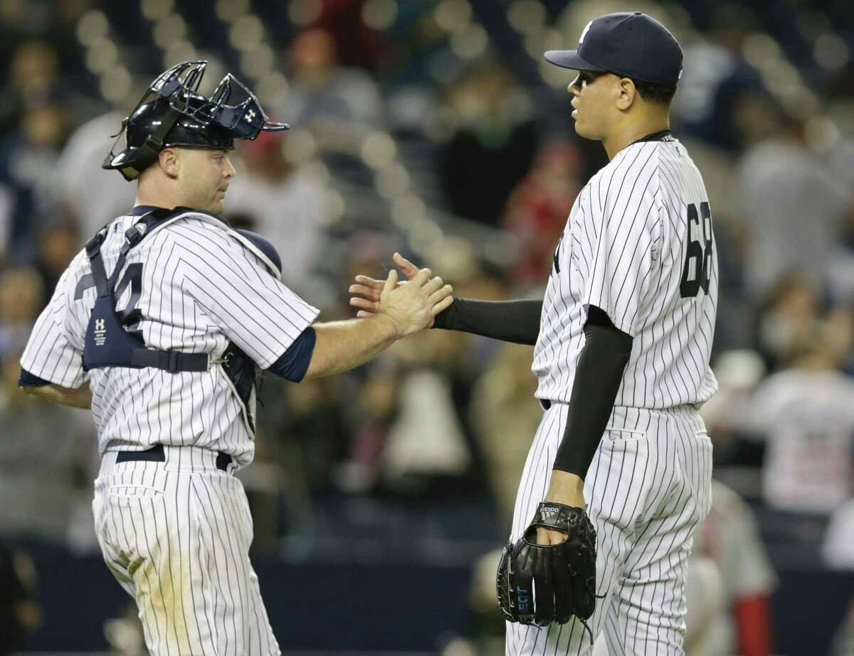 Yankees reliever Dellin Betances celebrates with catcher Brian McCann after Friday's win over the Los Angeles Angels in New York.