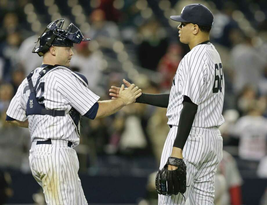 Yankees reliever Dellin Betances celebrates with catcher Brian McCann after Friday's win over the Los Angeles Angels in New York. Photo: Frank Franklin II — The Associated Press  / AP
