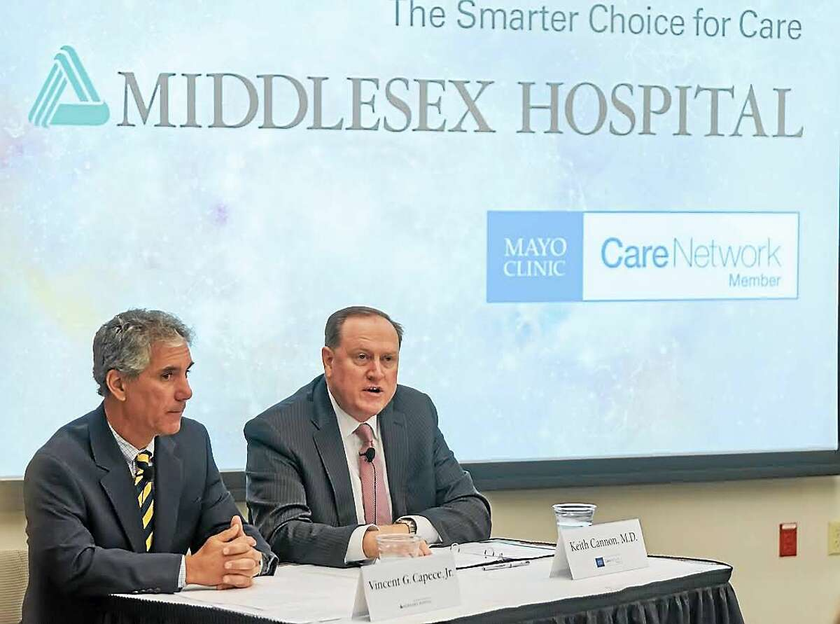 Middlesex Hospital President and CEO Vincent G. Capece Jr., left, and Dr. Keith Cannon, southwest medical director of the Mayo Clinic Care Network, right, speak during a press conference Thursday in Middletown announcing the new partnership.