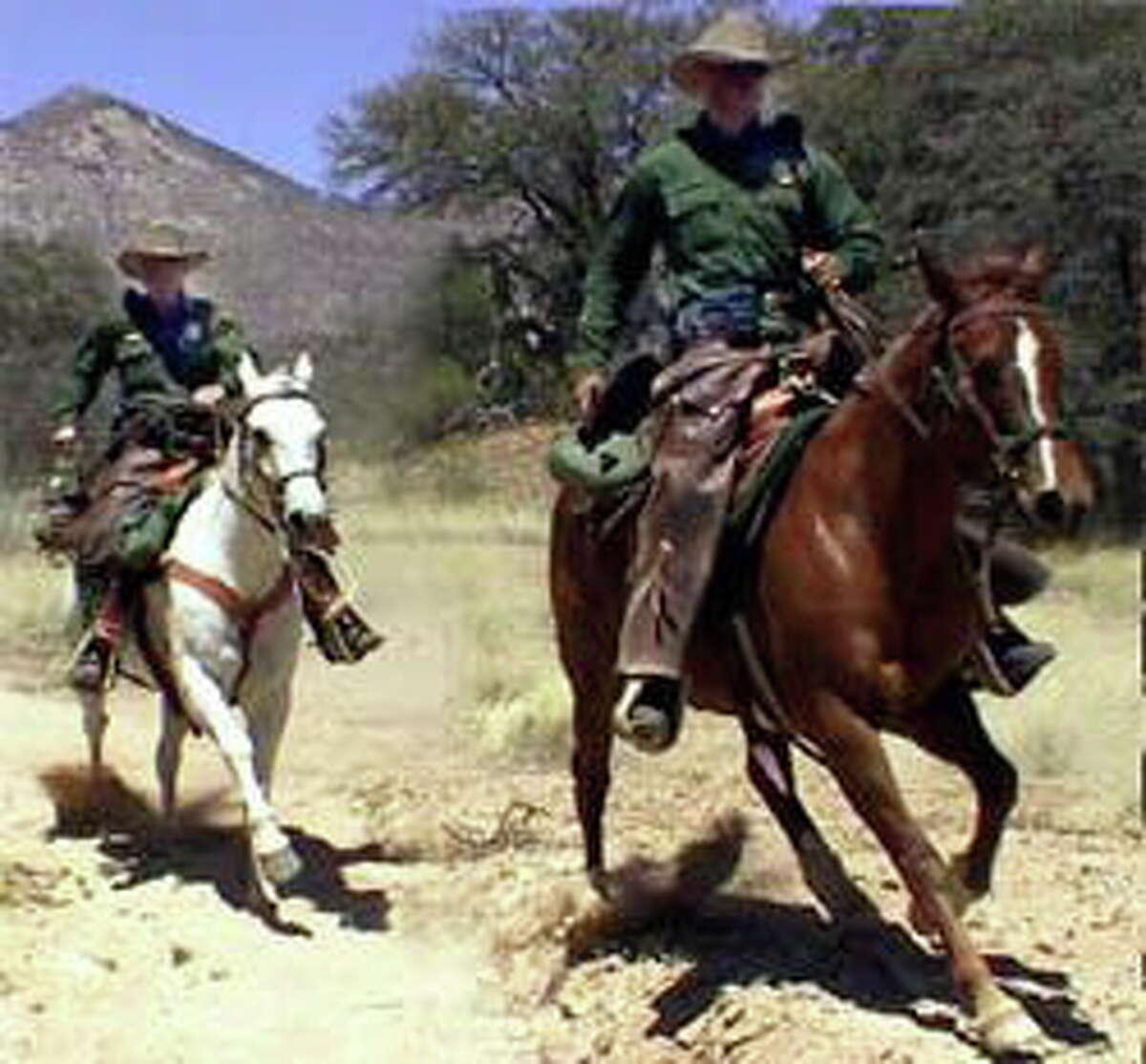 U.S. Border agents patrol on horseback.