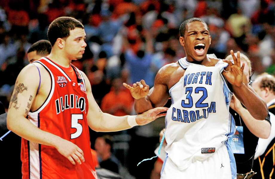 Illinois' Deron Williams congratulates North Carolina's Rashad McCants after UNC beat the Illini 75-70 in the national championship game in 2005 in St. Louis. Photo: Jeff Roberson — The Associated Press File Photo  / AP
