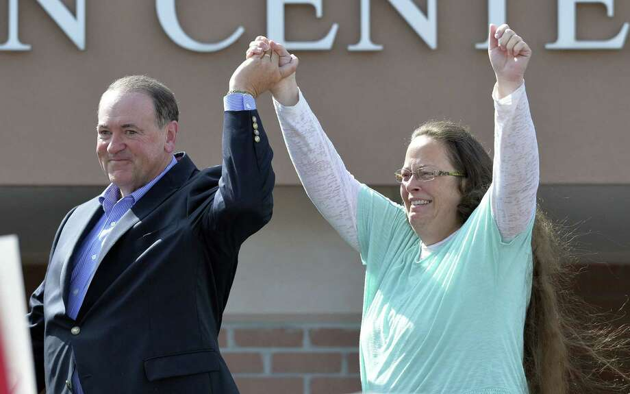 In this Tuesday, Sept. 8, 2015, file photo, Rowan County Clerk Kim Davis, with Republican presidential candidate Mike Huckabee at her side, greets the crowd after being released from the Carter County Detention Center, in Grayson, Ky. Politicians who may have thought they wouldnít have to say much at all about gay marriage once the U.S. Supreme Court effectively legalized it are being called on to say whether they support Davis. Photo: AP Photo/Timothy D. Easley, File   / FR43398 AP