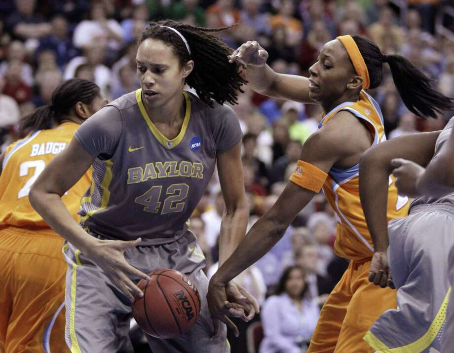 In this March 2012 file photo, Baylor's Brittney Griner grabs a rebound in front of Tennessee's Glory Johnson. Photo: Charlie Neibergall — The Associated Press File Photo  / AP