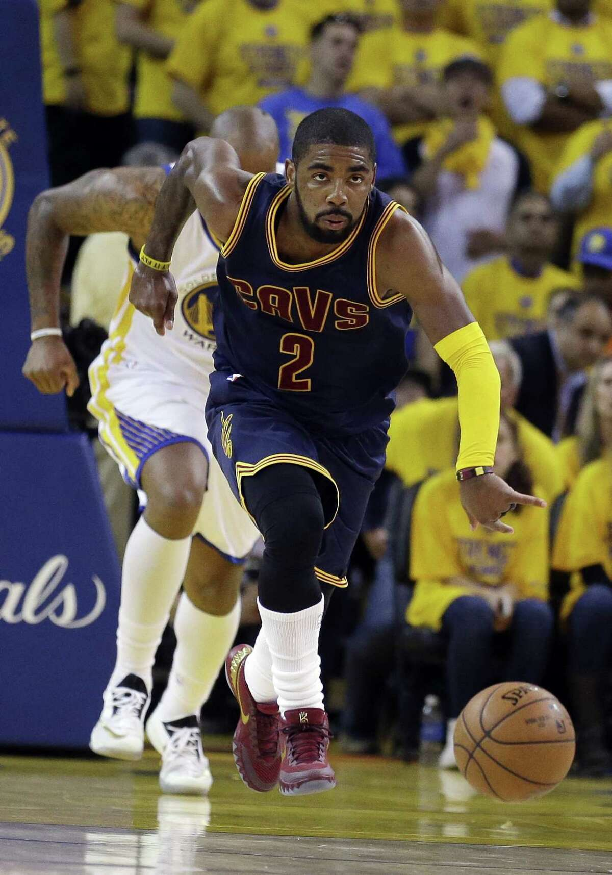 Cleveland Cavaliers guard Kyrie Irving dribbles up the floor against the Golden State Warriors during Game 1 of the NBA Finals on Thursday night in Oakland, Calif.