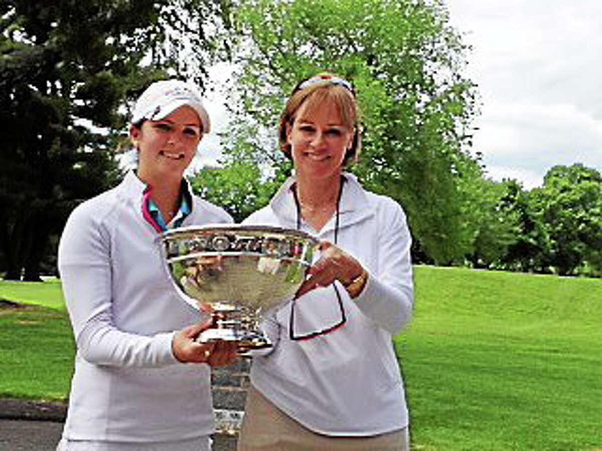 Mackenzie Hawkes, left, poses with the CWGA Championship trophy after her win on Friday. At right is Carol Galbraith of the CWGA.