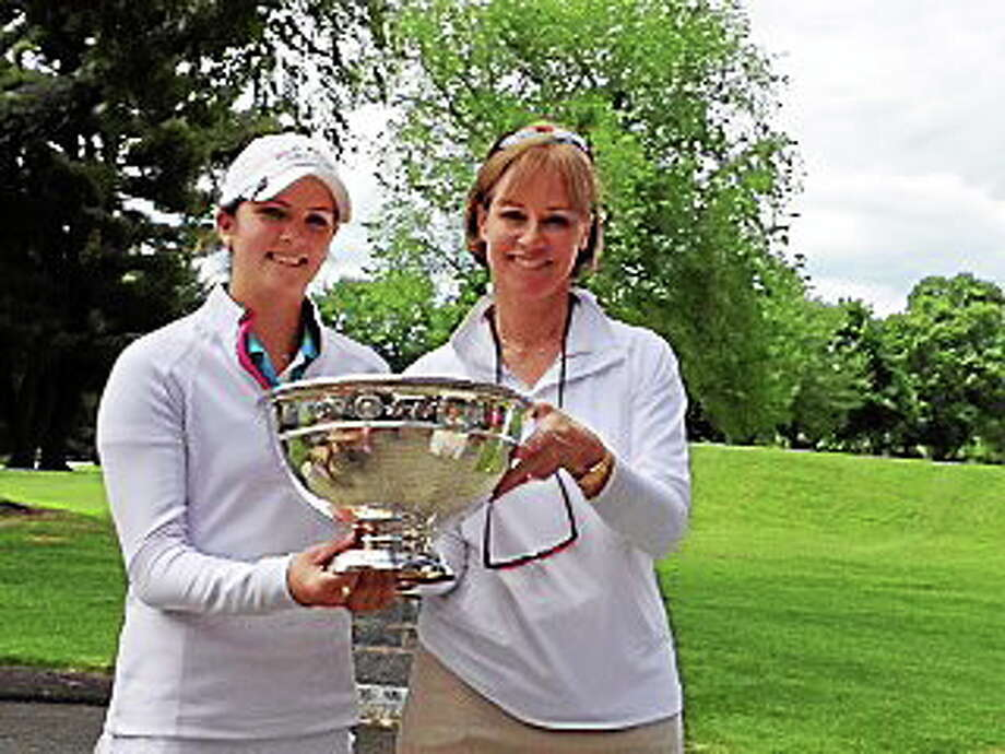 Mackenzie Hawkes, left, poses with the CWGA Championship trophy after her win on Friday. At right is Carol Galbraith of the CWGA. Photo: Joe Morelli — Register