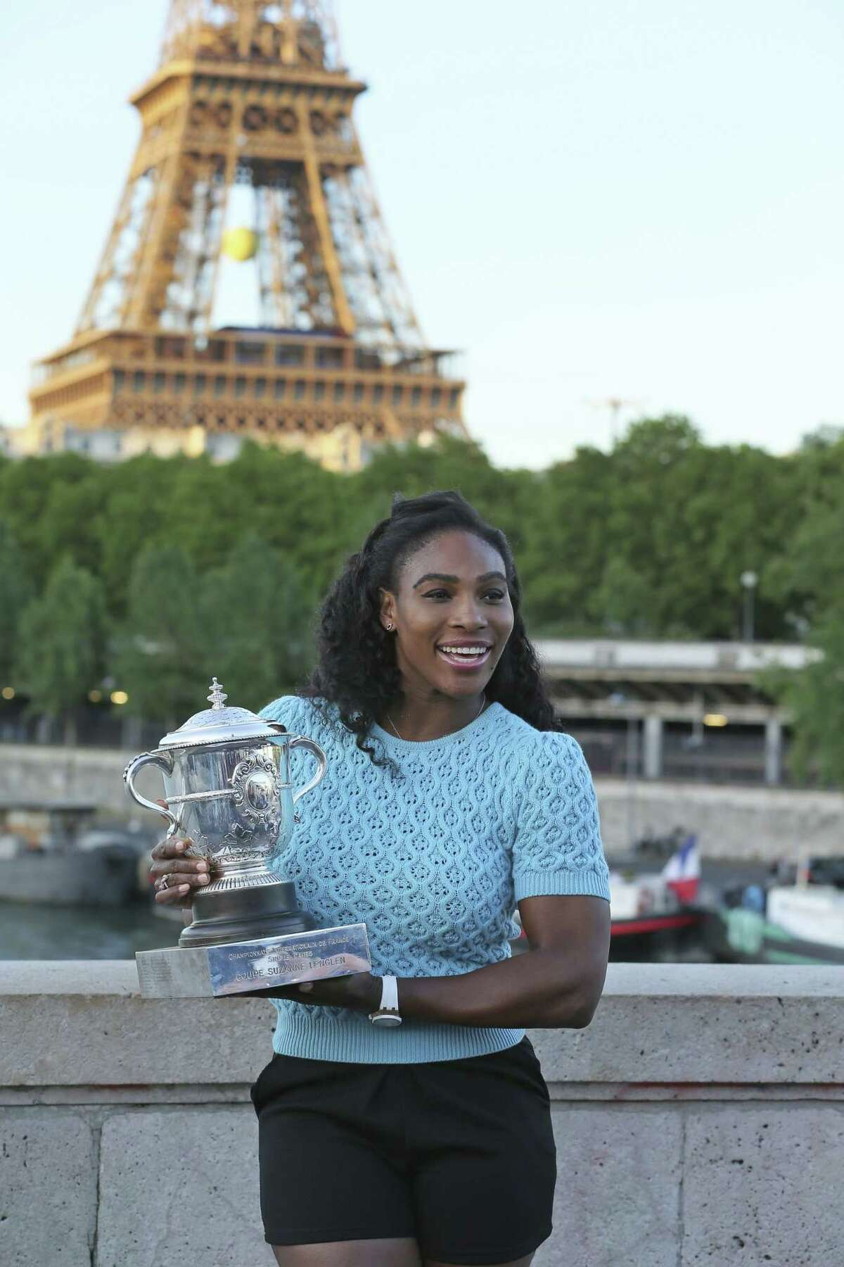 Serena Williams poses with her trophy after defeating Lucie Safarova 6-3, 6-7, 6-2 in the women's final of the French Open on Saturday at Roland Garros Stadium in Paris.