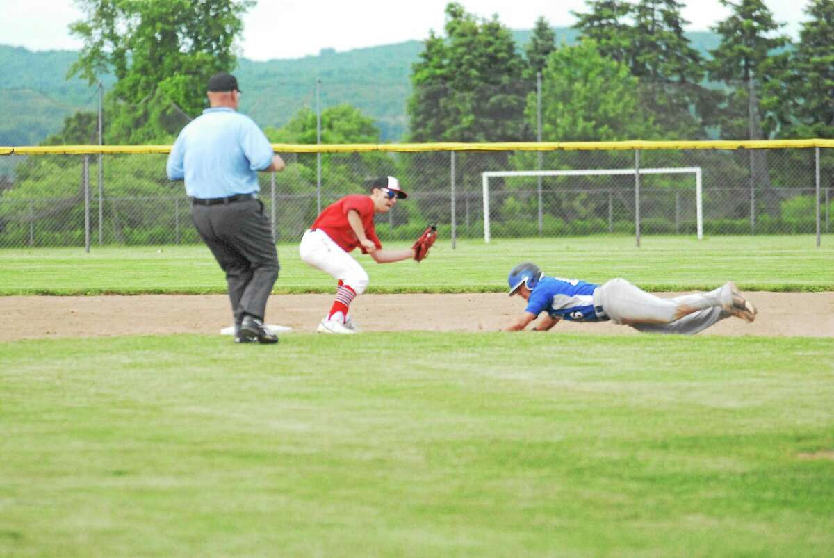 Portland second baseman Mike Bordonaro gets ready to tag out Old Lyme's Bill Buscetto in the first inning Friday at Dyer Field.