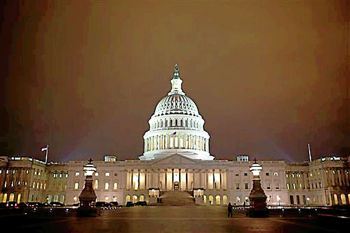 The lights of the U.S. Capitol remain lit into the night as the House continues to work on the