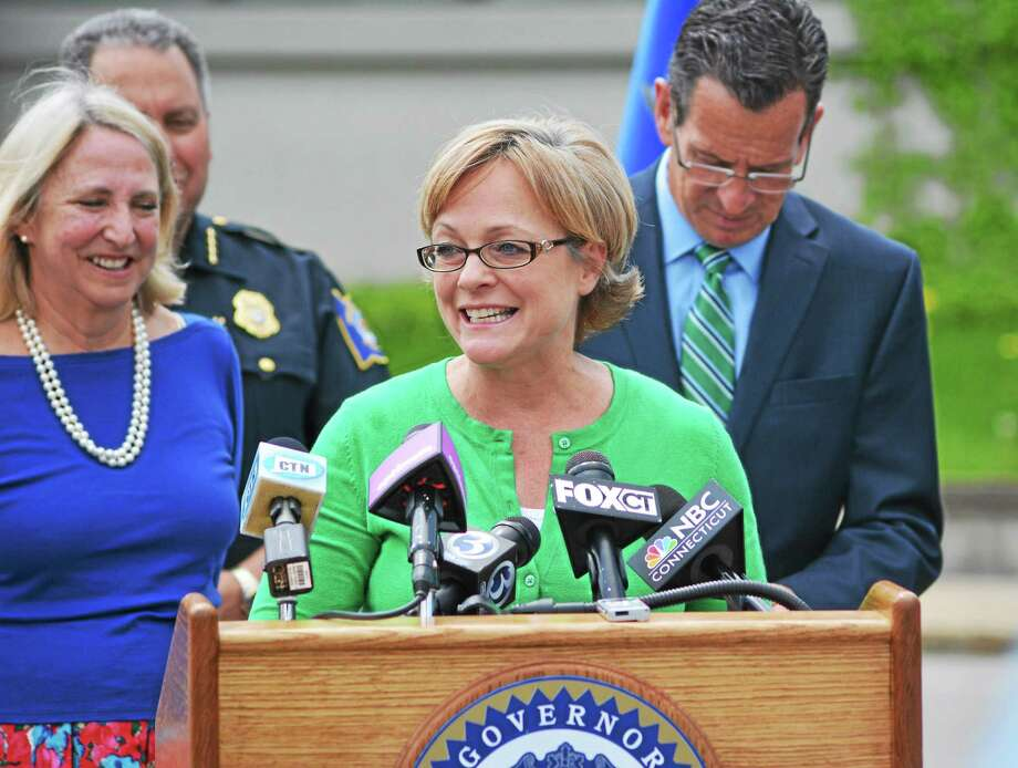 Torrington Mayor Elinor Carbone speaks at a press conference about the long-awaited courthouse to be built on Field St. in Torrington. Behind her are State Rep Roberta Willis, D-Lakeville, Torrington Police Chief Michael Maniago and  Governor Dannel Malloy. Photo: Register Citizen File Photo
