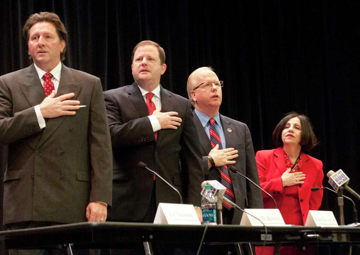 Petitioning gubernatorial candidate Joe Visconti, left, at a Republican primary debate in February.