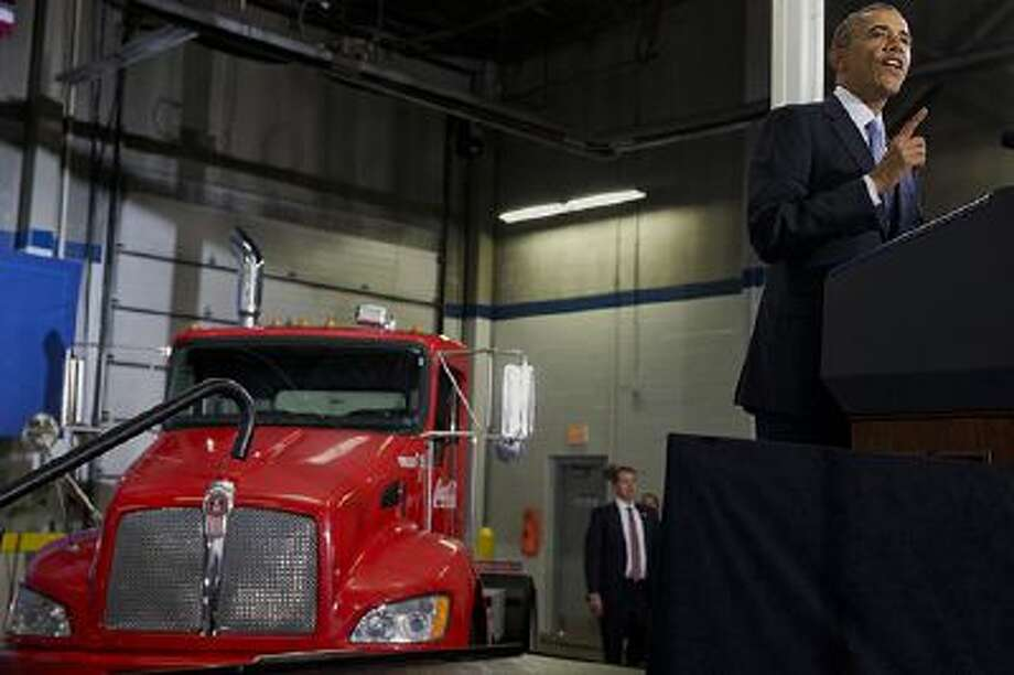 President Barack Obama speaks about how having a fuel-efficient truck fleet can boost the economy and help combat climate change, Tuesday, Feb. 18, 2014, at the Safeway Distribution Center in Upper Marlboro, Md. Photo: AP / AP