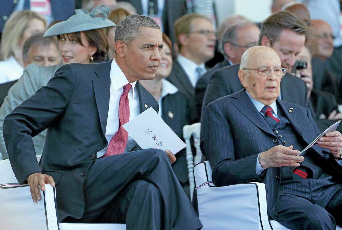 President Barack Obama sits with Italian President Giorgio Napolitano as they take part in the 70th anniversary of D-Day at Sword Beach in Ouistreham, France, Friday, June 6, 2014.