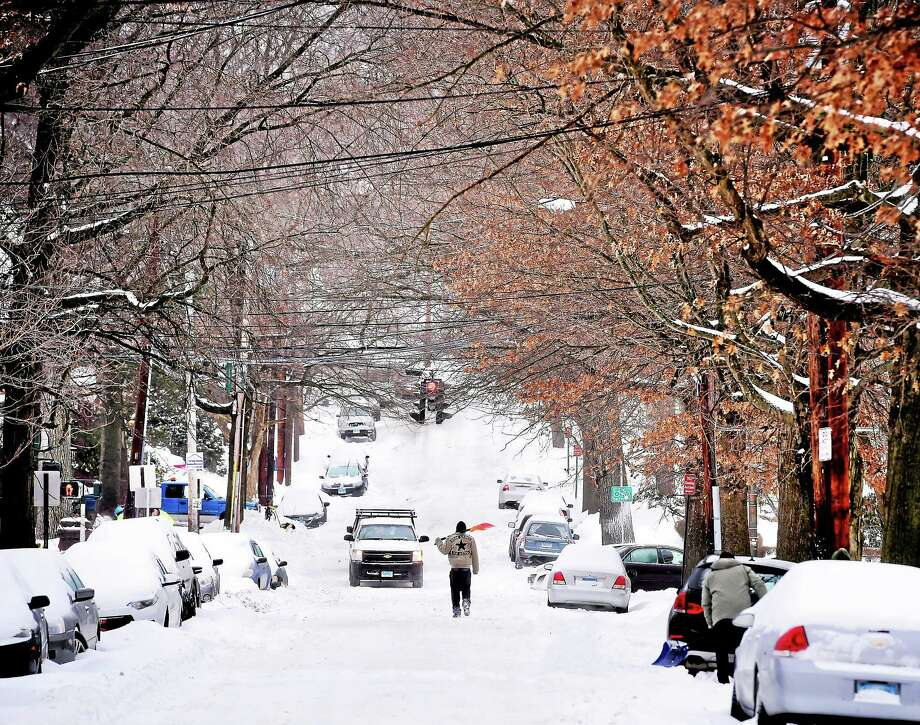 A shoveler makes his way toward Whitney Ave. in New Haven on 2/2/2015. Photo: (Arnold Gold-New Haven Register)