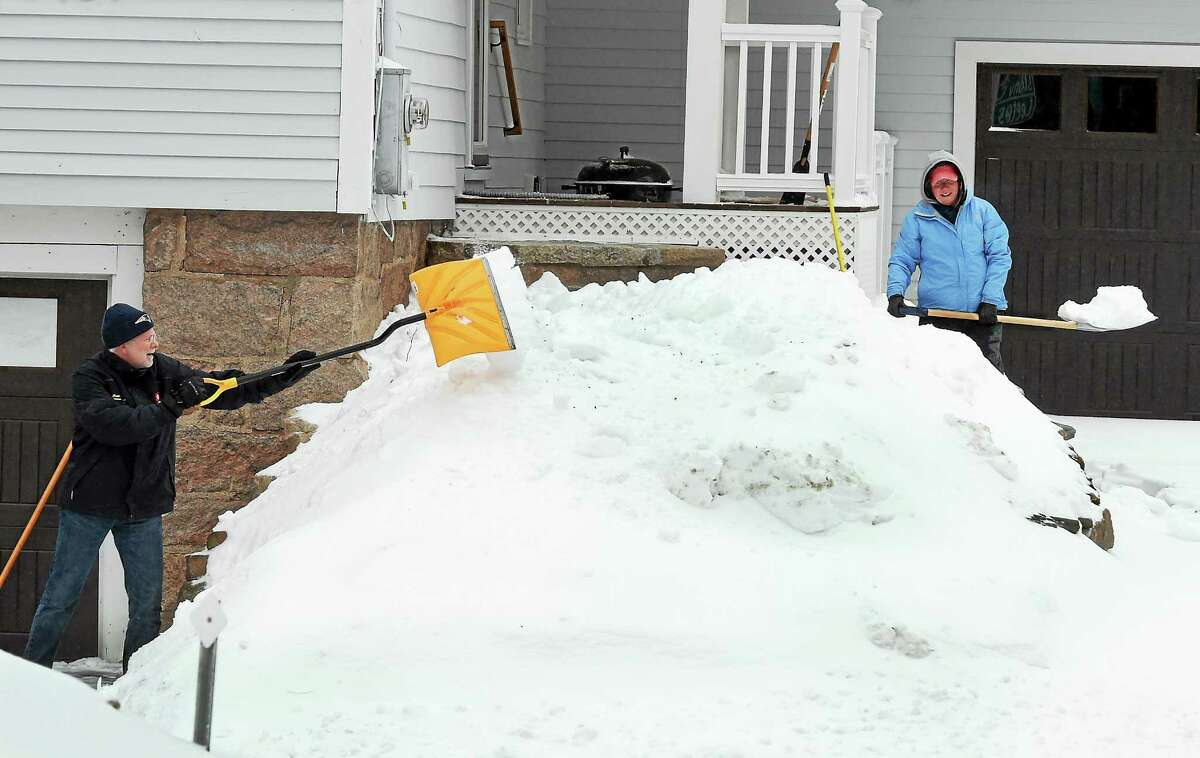 Bob and Maureen Lamb clear their two driveways of snow at their Thimble Island Road home in Branford, Conn. Monday, February 2, 2015.