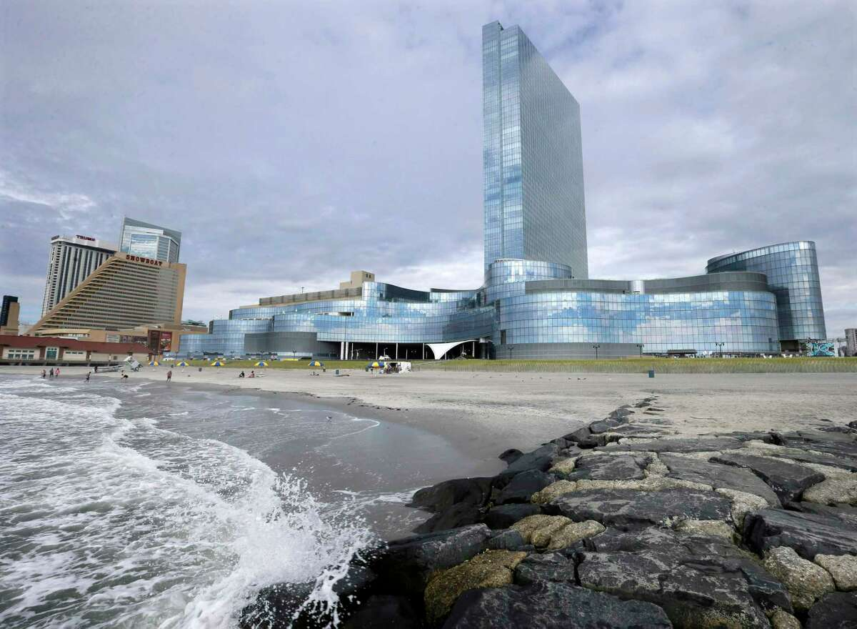 FILE - In this Monday, Sept. 1, 2014 file photograph, the closing Revel Casino Hotel, right, is seen next to the already closed Showboat Casino Hotel in Atlantic City, N.J. When the $2.4 billion Revel Casino Hotel on the Atlantic City Boardwalk, closed, it was the most spectacular and costly failure in Atlantic City's 36-year history of casino gambling. On Tuesday, Sept. 30, 2014, a bankruptcy court auction for Revel is scheduled to resume. An auction that began a week earlier was suspended due to the Rosh Hashanah holiday. (AP Photo/Mel Evans, File)