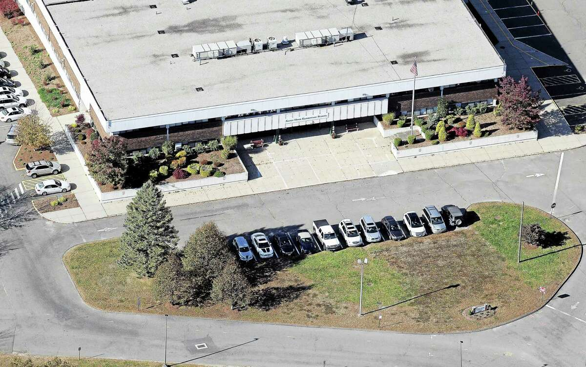 This Oct. 28, 2013, aerial photo shows the Sandy Hook Elementary School in the former Chalk Hill School building in Monroe, where students were relocated from Newtown.