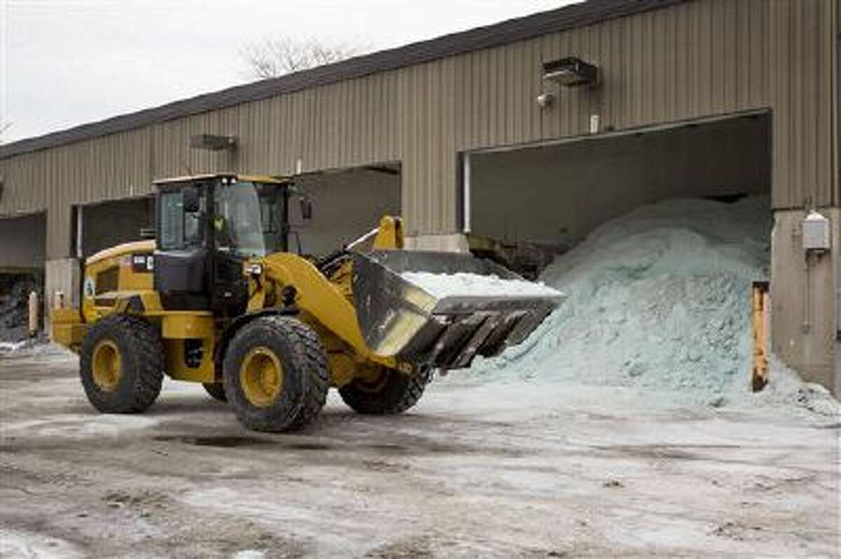 Road salt is unloaded Feb. 4 from storage at the public works facility in Glen Ellyn, Ill. The recent severe winter weather has caused communities to expend large amounts of their road salt supplies.