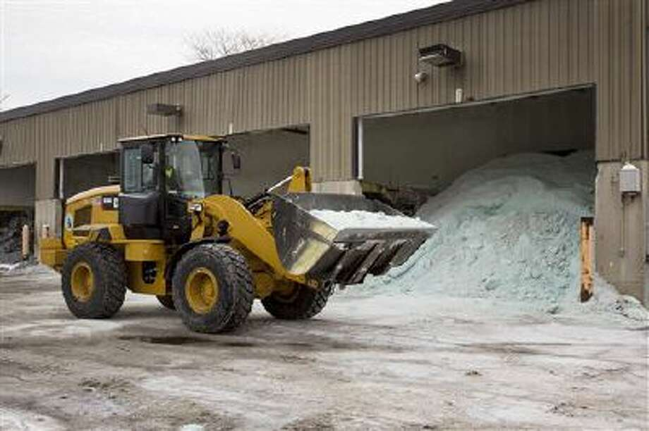 Road salt is unloaded Feb. 4 from storage at the public works facility in Glen Ellyn, Ill. The recent severe winter weather has caused communities to expend large amounts of their road salt supplies. Photo: AP / FR170974 AP