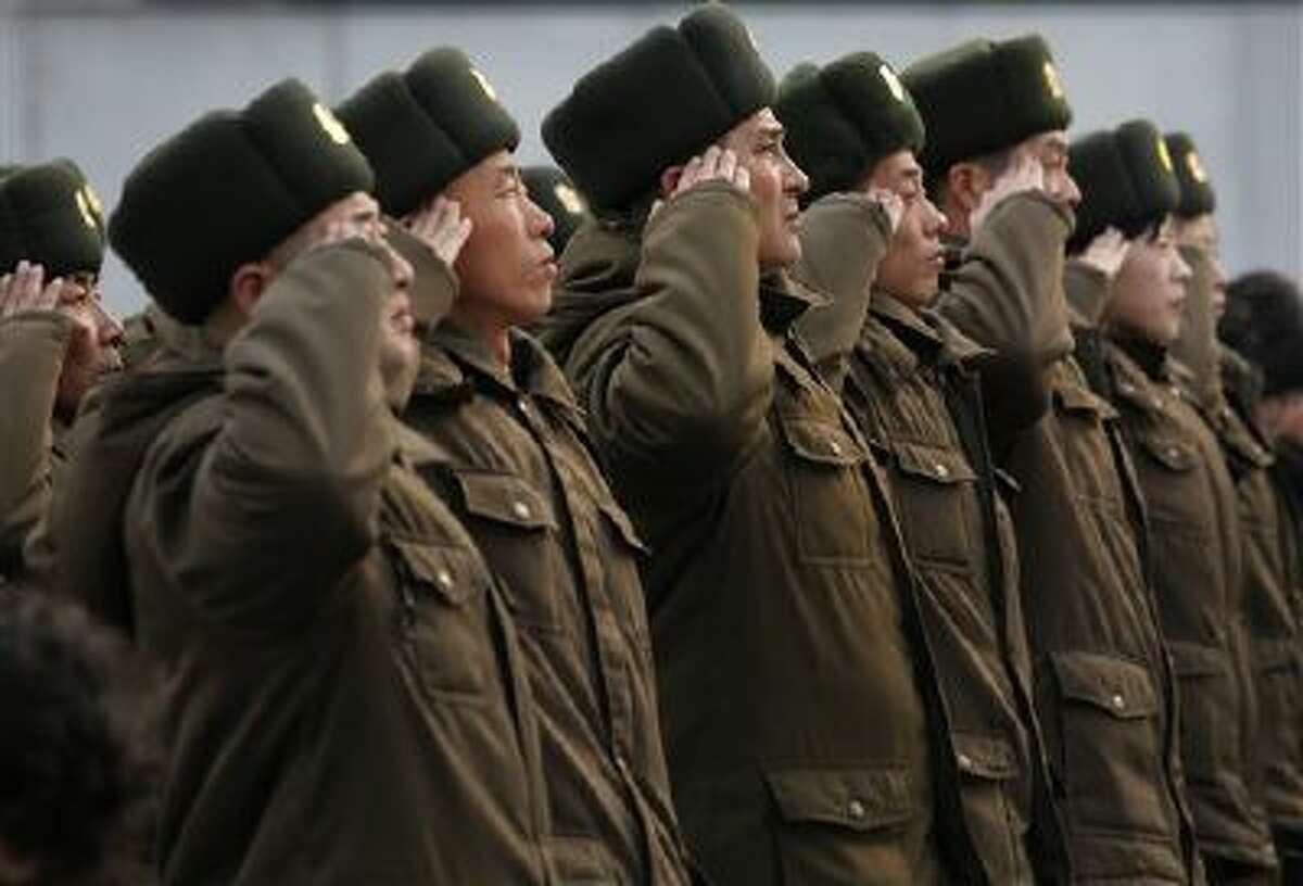 North Korean soldiers salute in Pyongyang, North Korea.