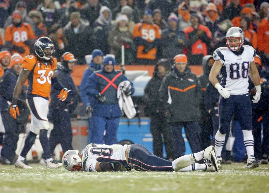 Patriots tight end Rob Gronkowski lies injured on the field against the Broncos during the fourth quarter Sunday in Denver. Photo: Joe Mahoney — The Associated Press  / FR170458 AP