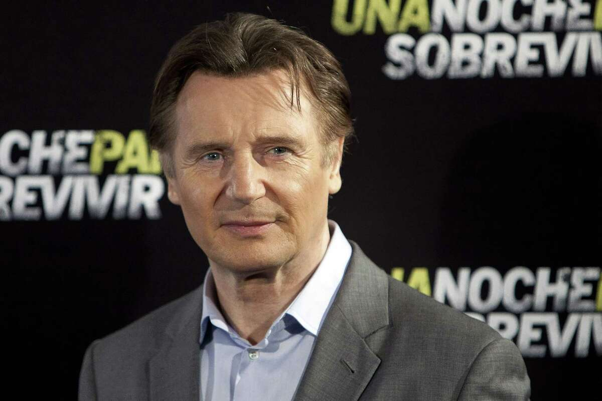 Actor Liam Neeson poses for photographers in Madrid.