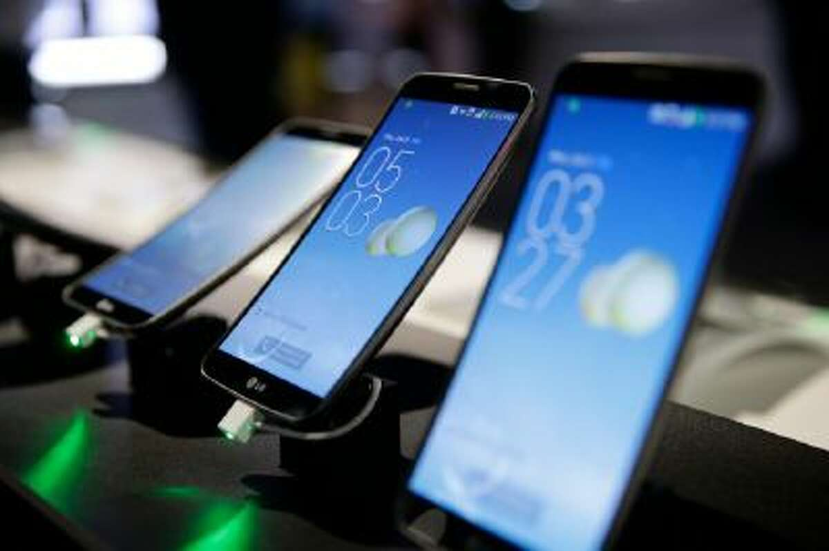 LG's G Flex smartphones are displayed at the International Consumer Electronics Show(CES) on Jan. 9, 2014, in Las Vegas.