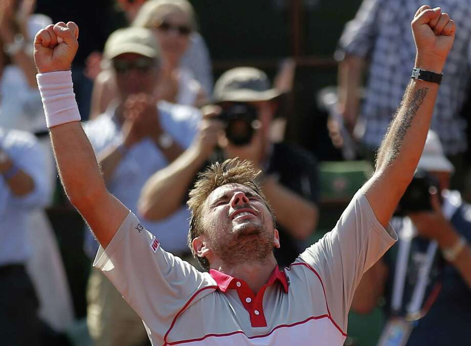 Stan Wawrinka clenches his fists after defeating Jo-Wilfried Tsonga during their semifinal match at the French Open Friday at Roland Garros Stadium in Paris. Photo: Francois Mori — The Associated Press  / AP