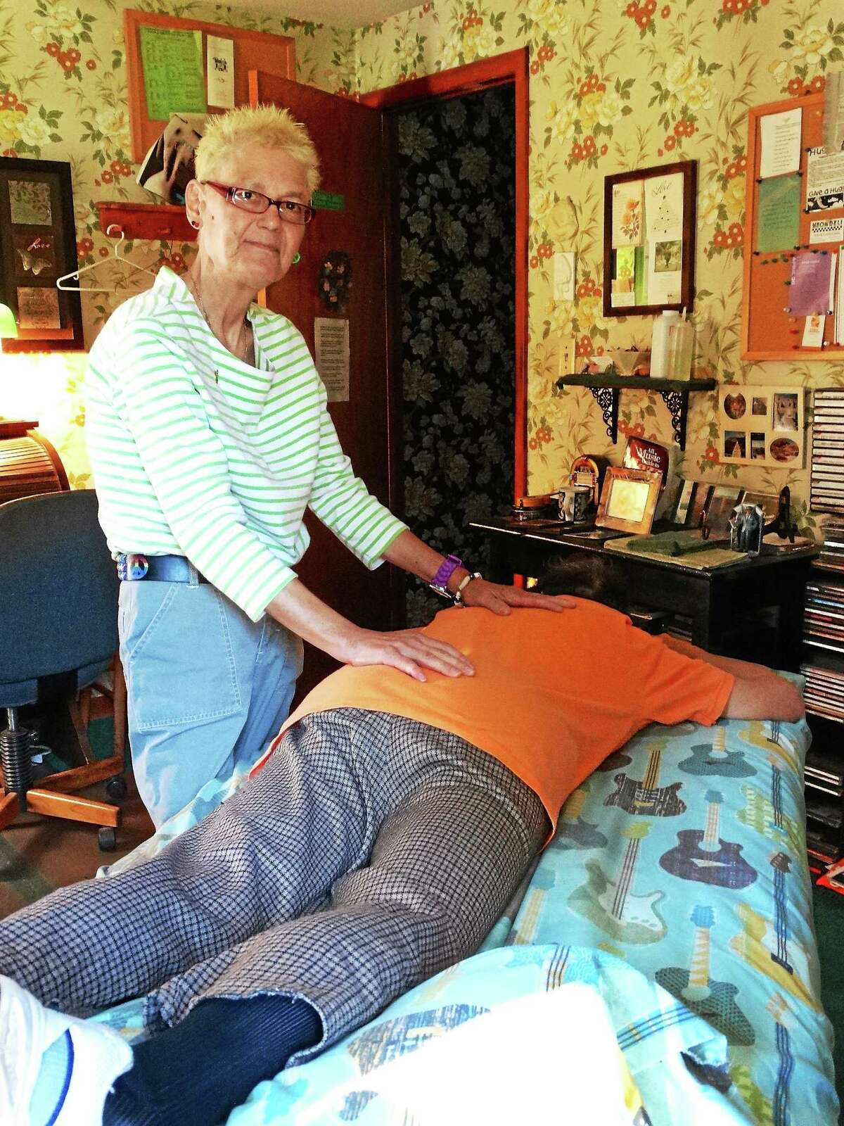 Middletown massage therapist Lorraine Dobek is a recovering alcoholic who has used her occupation to heal herself and others.