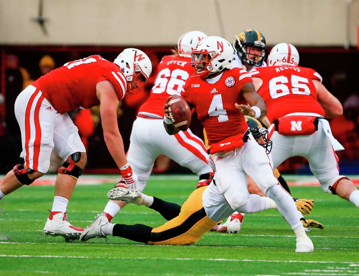 Nebraska quarterback Tommy Armstrong Jr. rolls out of the pocket during Friday's game against Iowa.