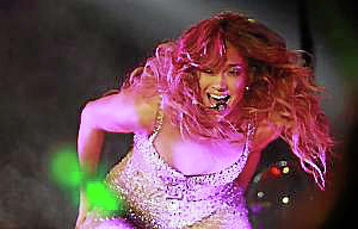 In this Nov. 24, 2012, file photo, Jennifer Lopez performs during her concert in Shanghai, China.
