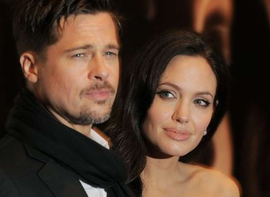 """Actor Brad Pitt and actress Angelina Jolie attend a New York Film Festival screening of """"Changeling"""" at the Ziegfeld Theatre on Saturday, Oct. 4, 2008 in New York. (AP Photo/Evan Agostini) Photo: AP / AGOEV"""