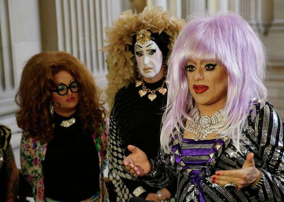 FILE - In this Sept. 17, 2014 file photo, drag queens from left, Lil Ms. Hot Mess, Sister Roma and Heklina, take turns speaking about their battle with Facebook during a news conference at City Hall in San Francisco, Calif. Facebook on Wednesday Oct. 1, 2014 apologized to drag queens and the transgender community for deleting accounts that used drag names like Lil Miss Hot Mess rather than legal names such as Bob Smith. Photo: (AP Photo/Eric Risberg, File) / AP