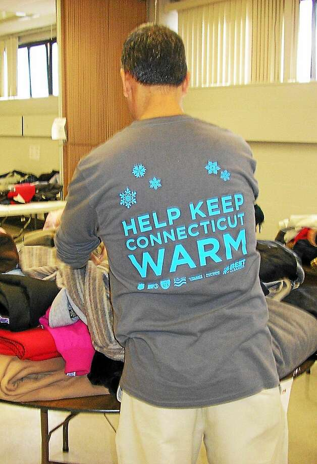 Best Cleaner's 2014-2015 Coats for Connecticut campaign helped keep 16,000 in Connecticut warm this winter with donated coats collected and cleaned by Best Cleaners and delivered to Salvation Army Centers. Pictured here organizing one delivery at the Salvation Army in Hartford is Best Cleaners Delivery Driver Marco Lu. Photo: Courtesy Sphoto