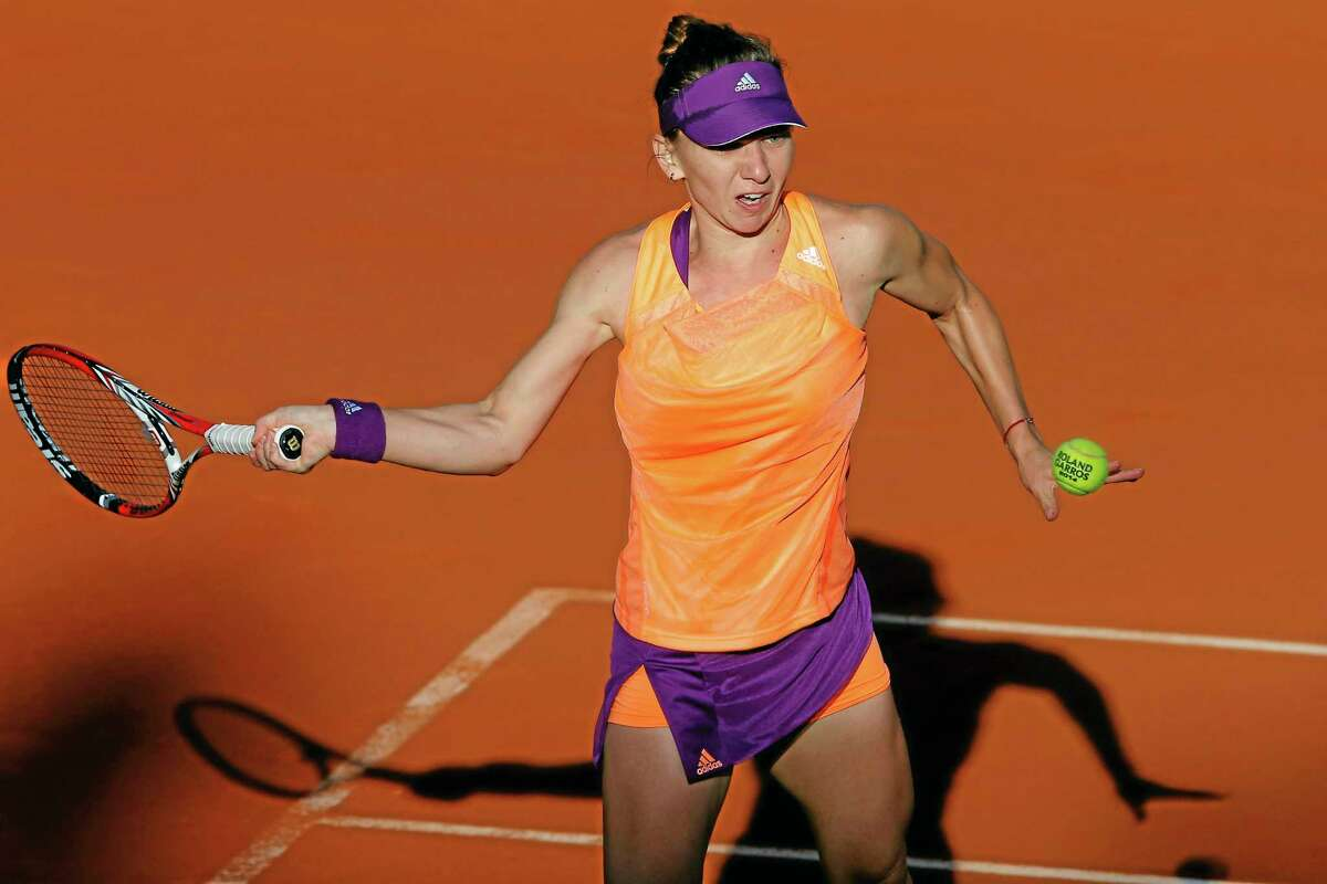 Simona Halep returns the ball during the semifinals of the French Open against Andrea Petkovic on Thursday at the Roland Garros stadium in Paris. Halep won 6-2, 7-6.