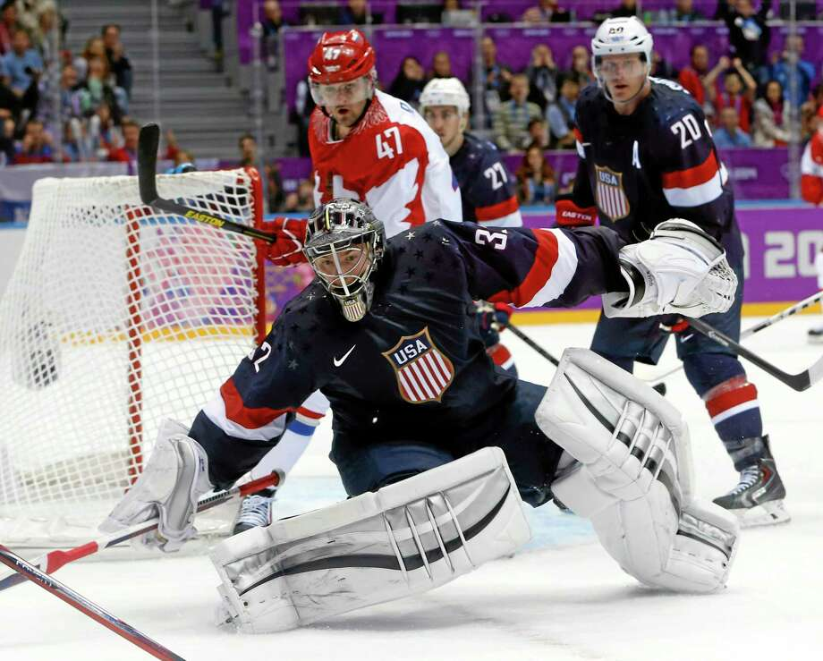 Team USA goaltender Jonathan Quick of Hamden comes out of the crease to defend the goal in the third period of Saturday's win over Russia at the Winter Olympics in Sochi, Russia. Photo: Mark Humphrey — The Associated Press  / AP
