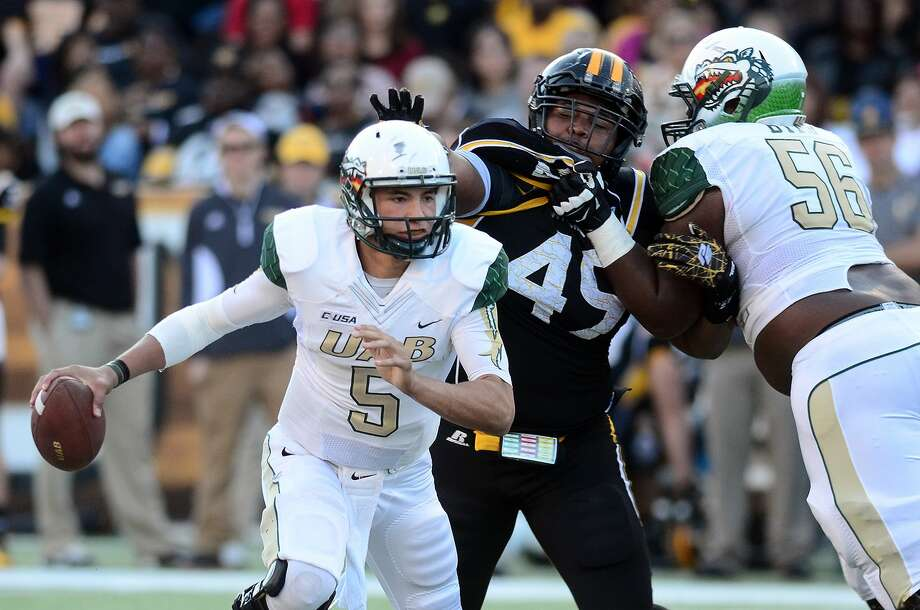 UAB quarterback Cody Clements (5) scrambles out of the backfield during Saturday's game against Southern Mississippi. Photo: The Associated Press  / Hattiesburg American