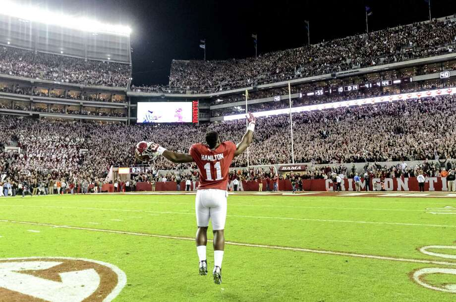 Alabama linebacker Shaun Dion Hamilton (11) celebrates after the Crimson Tide's win over Auburn on Saturday. Photo: The Associated Press  / AL.com