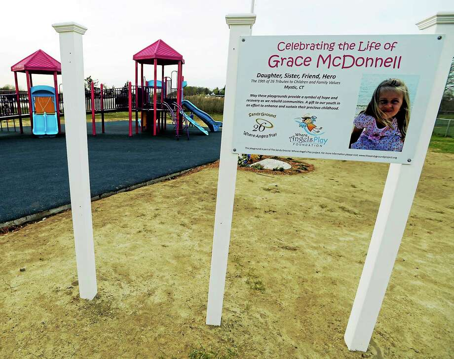 This May 7, 2014 photo shows a gap shows where one of the brand new signs, depicting a peace sign, for the Grace McDonnell playground in Stonington, Conn. was stolen. Photo: AP Photo/The Day, Tim Martin  / The Day