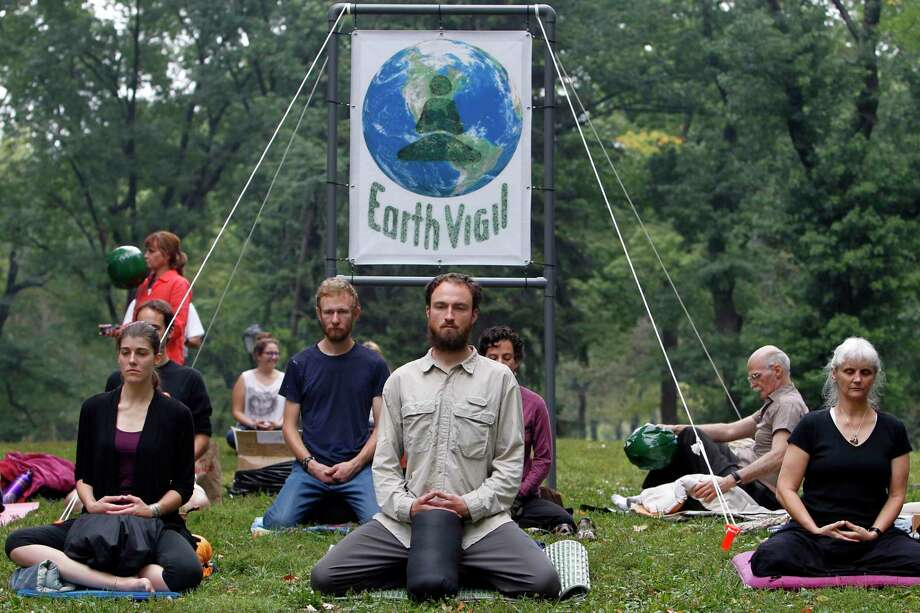 Demonstrators gather in Central Park before the People's Climate in March 2014 in New York. During this week's United Nations Climate Summit, where more than 120 world leaders will convene for a meeting aimed at galvanizing political will for a new global climate treaty by the end of 2015. (AP Photo/Jason DeCrow) Photo: File  / FR103966 AP