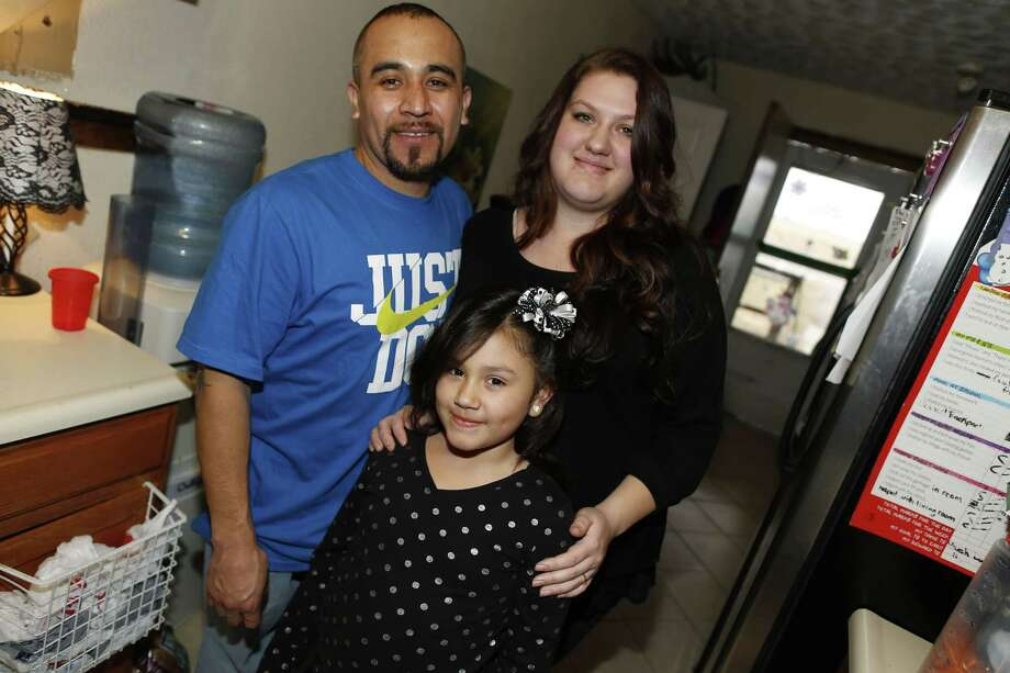 Maximiano Vazquez-Guevara, left, his wife Ashley Bowen, and their 6-year-old daughter, Nevaeh Vazquez, pose for a photo in their home on Jan. 31, 2015, in the northeast Denver suburb of Commerce City, Colo. Photo: AP Photo/David Zalubowski  / AP