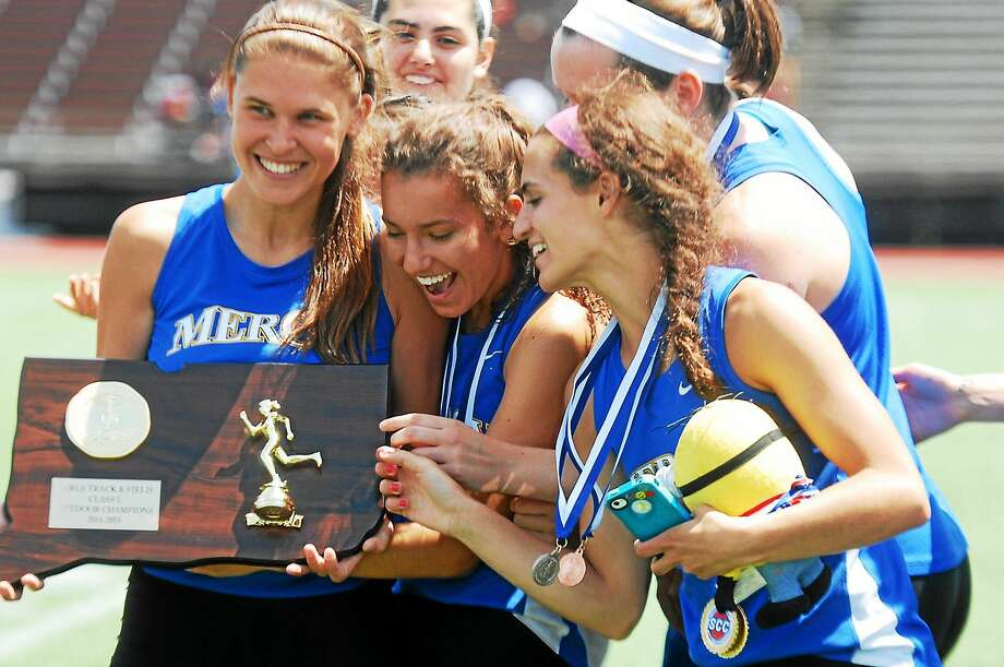 The Mercy High girls' track team looks at their state title Wednesday afternoon. Photo: Mary Albl--New Haven Register
