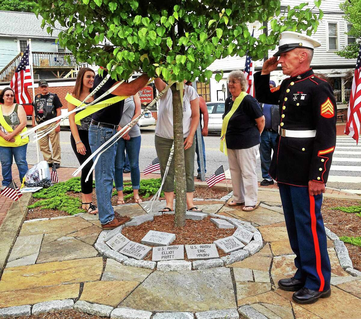 Jeff Mill - The Middletown Press From left are Megan, Caitlin, Susan and Jeff Beebe of East Hampton, the family of marine Jacob Beebe who was deployed to Afghanistan.