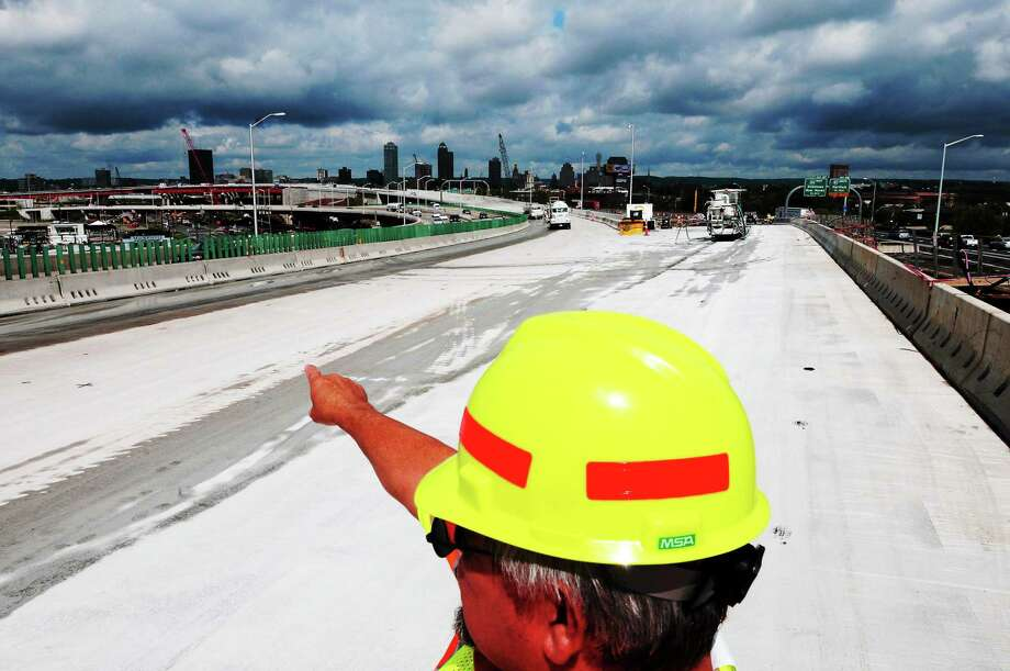 """Connecticut DOT Assistant District Engineer Brian Mercure stands on the Pearl Harbor Memorial Bridge, also known as the """"Q bridge,"""" looking back towards New Haven July 23, 2013, as crews prepare for a traffic shift this weekend during the  I-95 New Haven Harbor Crossing Corridor Improvement Program. Photo: Peter Hvizdak — New Haven Register  / ©Peter Hvizdak /  New Haven Register"""