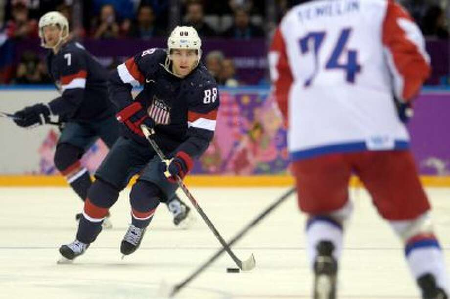 Patrick Kane (88) of the U.S.A. brings the puck up the ice against Russia during the first period of men's hockey action at Bolshoy arena. Sochi 2014 Winter Olympics on Saturday, February 15, 2014.