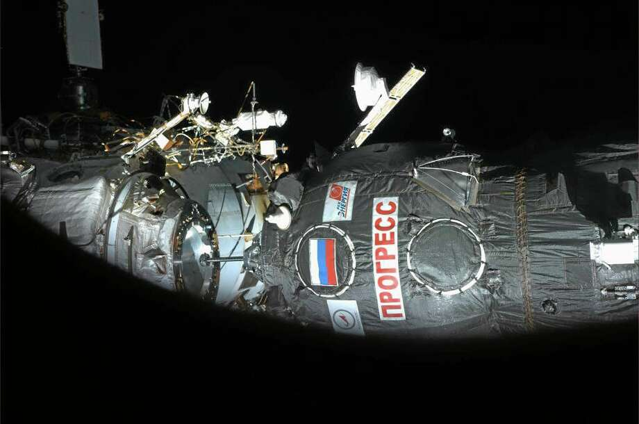 This image provided by NASA shows the Progress 54P  arriving at the International Space Station Wednesday Feb. 5, 2014 about one second before contact seen from a window of Soyuz TMA-11M module. (AP Photo/NASA, Koichi Wakata) Photo: AP / NASA