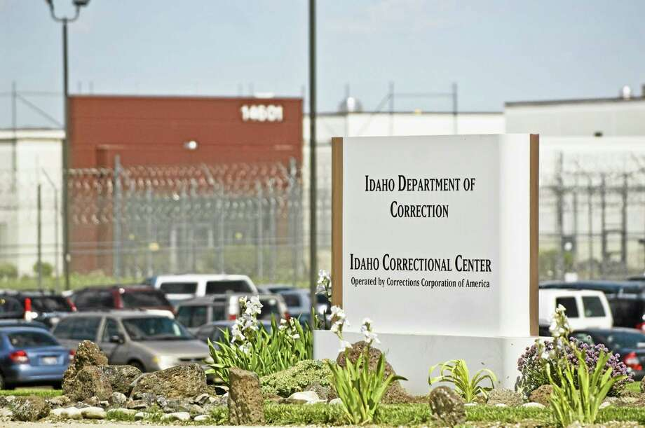 FILE - In this June 15, 2010 file photo, the Idaho Correctional Center is shown south of Boise, Idaho. A gang war that appears to have taken over parts of an Idaho private prison is spilling into the federal courts. A group of inmates at the Idaho Correctional Center is suing Corrections Corporation of America, contending the company is working with a few powerful prison gangs to control the facility and save money on staffing.(AP Photo/Charlie Litchfield, File) Photo: AP / FR164915 AP