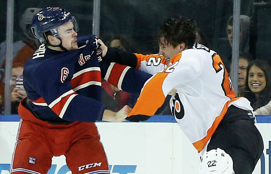 Rangers defenseman Dylan McIlrath (6) fights with Philadelphia Flyers defenseman Luke Schenn (22) during the first period Saturday. Photo: Julie Jacobson — The Associated Press  / AP