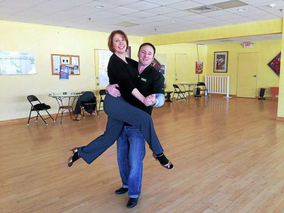 """East Haddam resident and WMRQ 104.1 FM radio host David Fisch trains with his dance partner and """"Dance In Rhythm"""" studio co-owner Karen Pfrommer in Branford. The duo will take part in the fifth annual Dancing Under the Stars fundraiser to benefit the Ronald McDonald Children's House of Connecticut on Friday, Feb. 28, in New Haven. Photo: Submitted Photo"""